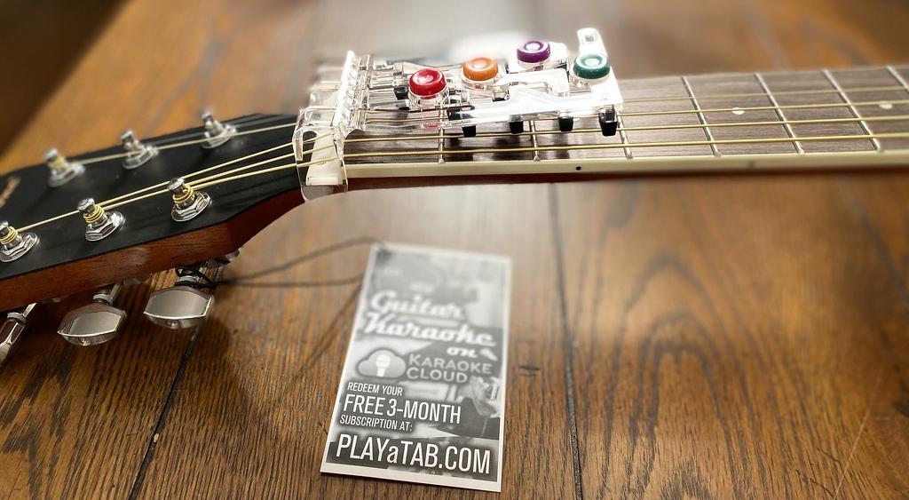 PlayATab Device on Ameritone Acoustic Guitar