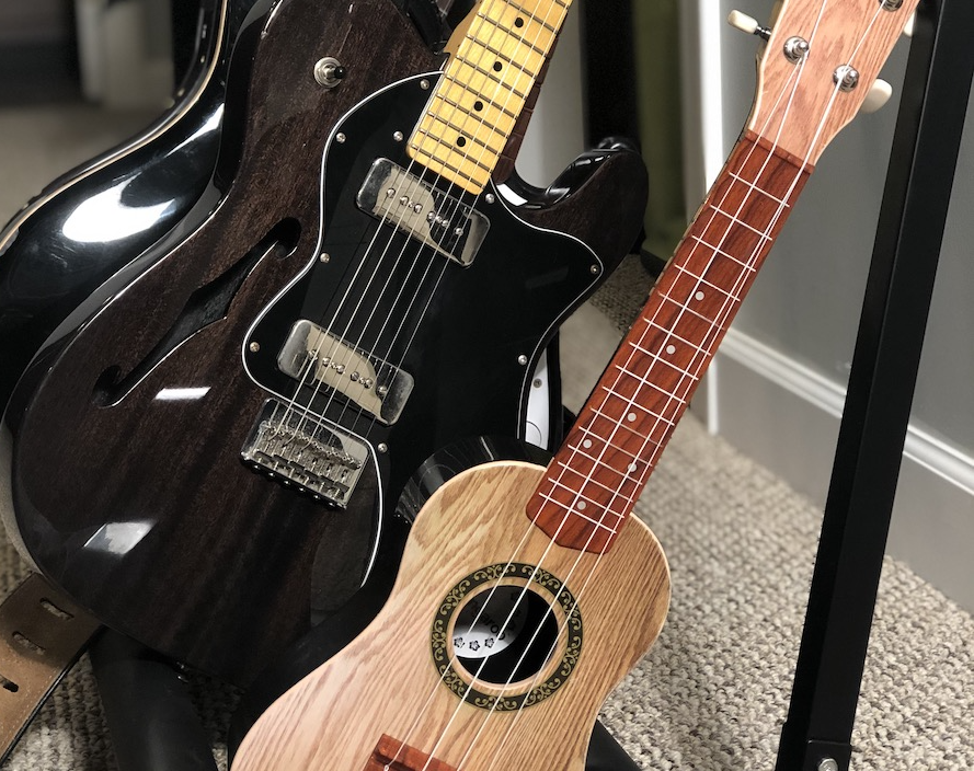 Ukulele in the Guitar Stand