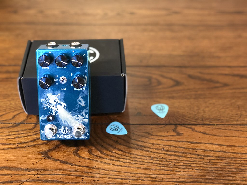 Walrus Audio Fathom reverb pedal with box and picks on a wooden table