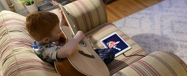 My son learning guitar on the iPad