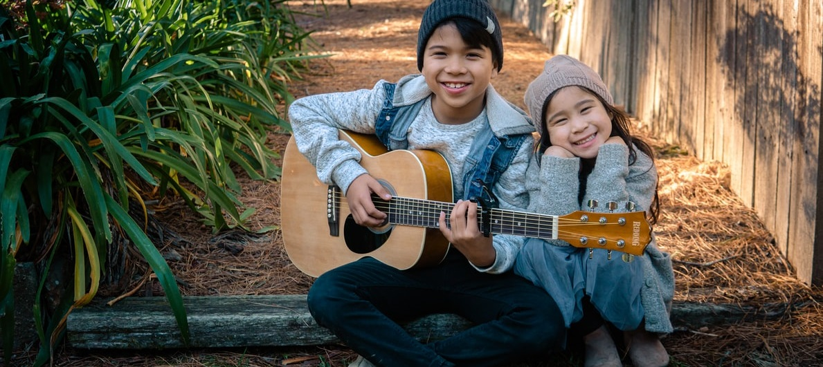 Kids Playing an Acoustic Guitar
