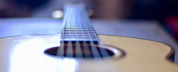Acoustic guitar with low action - banner photo